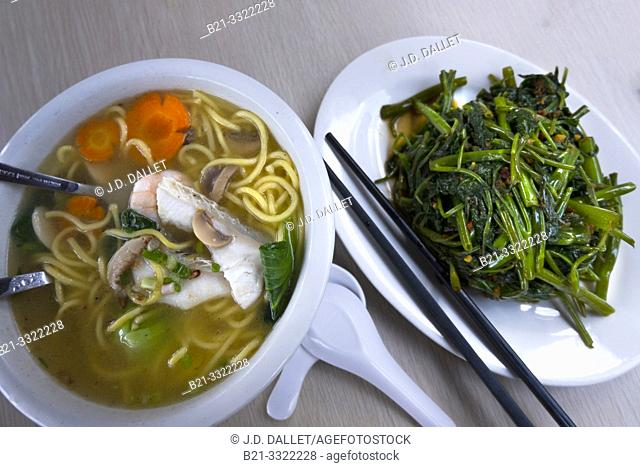 """Singapore, Food- a """"pho"""" (soup, with vegetables pork and noodles) and sauté green leaves"""