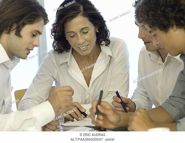 Business associates looking at document together