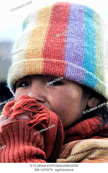 Girl wearing a colorful hat, Bolivian Altiplano highlands, Departamento Oruro, Bolivia, South America