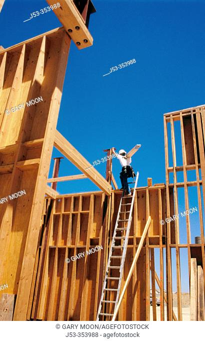 Carpenter climbing ladder. East Antelope, California. USA