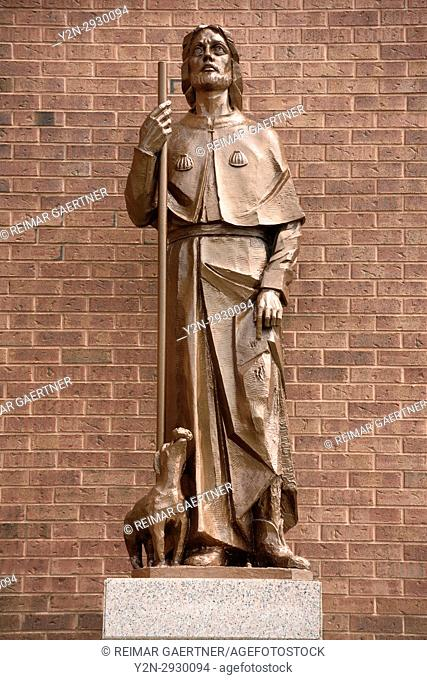 Statue of Saint Roch with injured leg and dog that brought him bread outside Saint Roch's Roman Catholic church Toronto Canada
