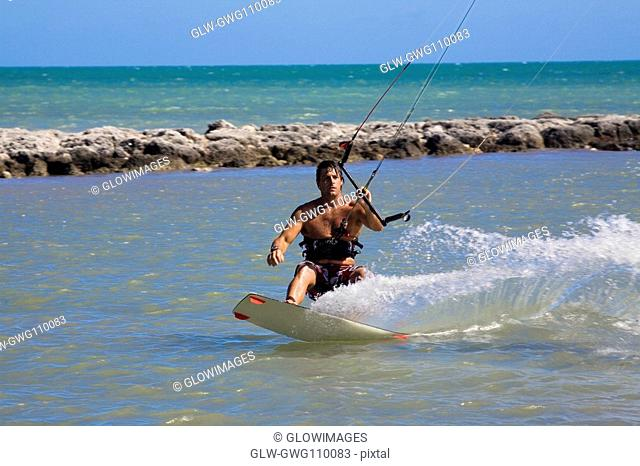 Young man kite boarding in the sea, Smathers Beach, Key West, Florida, USA