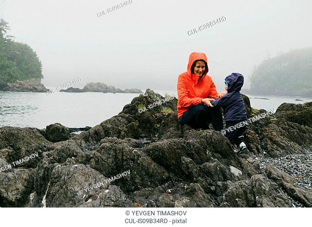 Mother and son on rocks, Vancouver Island, British Columbia, Canada