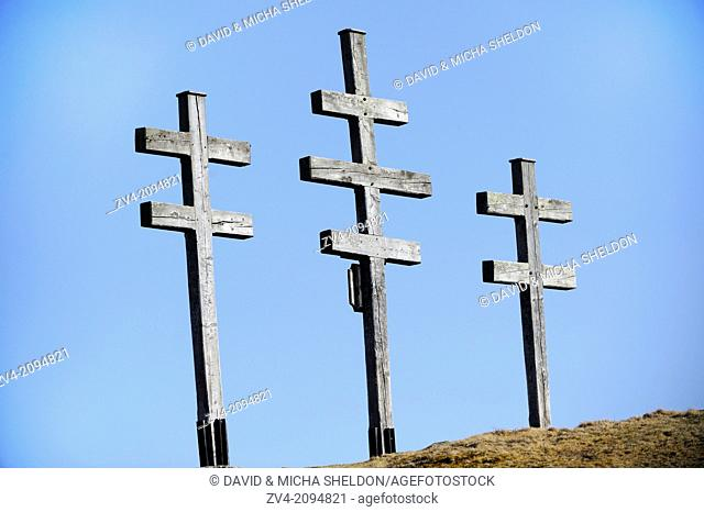 Close-up of three crucifixes standing on a mountain in Austria