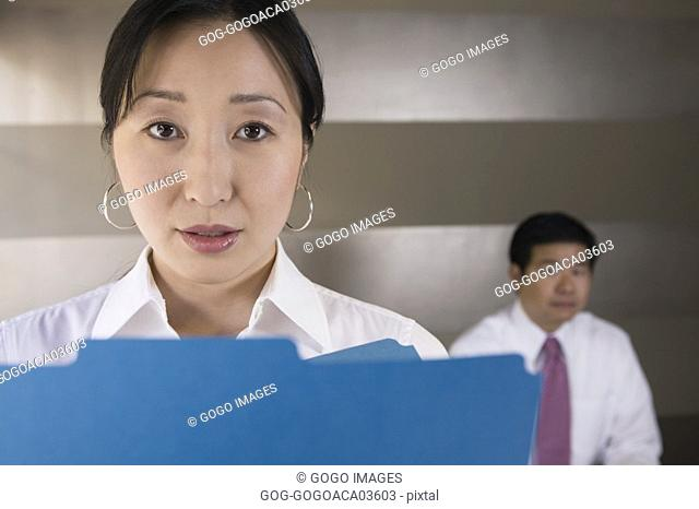 Businesswoman offering plastic folder