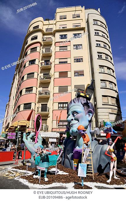 Typical falla scene with papier mache figures in the street during Las Fallas festival