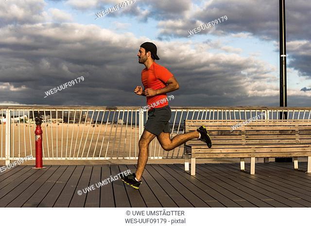USA, New York City, man running on Coney Island