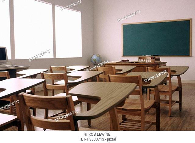 Empty desk in elementary school classroom