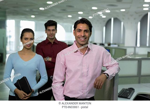 India, Smiling office workers looking at camera