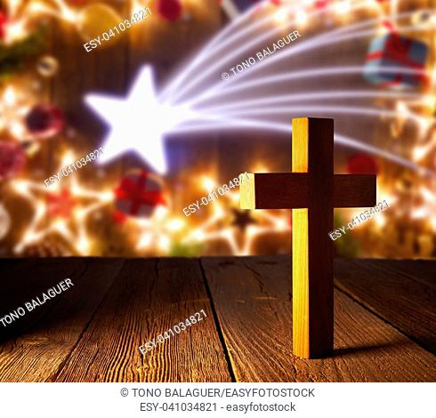 Christian wood cross on Christmas stars wooden background