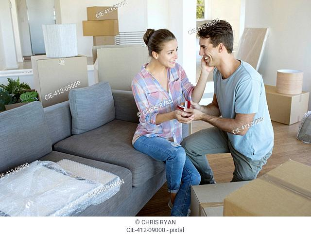 Man proposing to girlfriend in new house