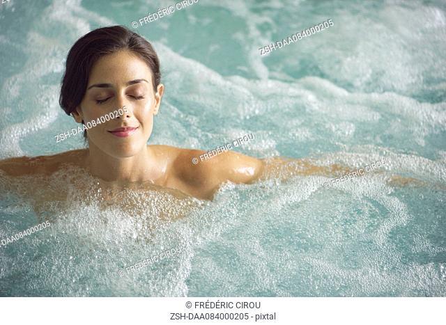 Woman soaking in spa pool
