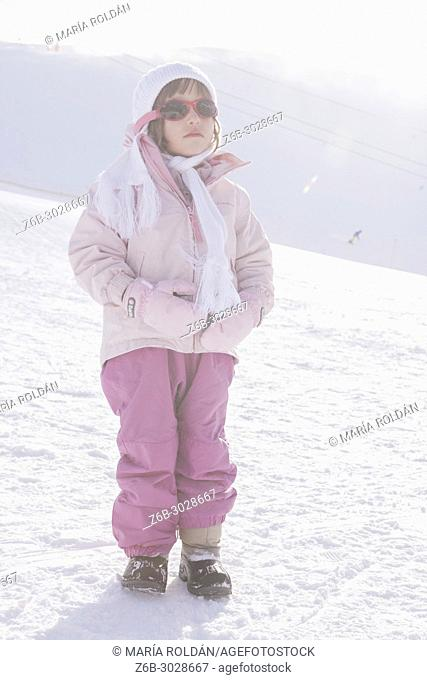 little girl in a ski resort