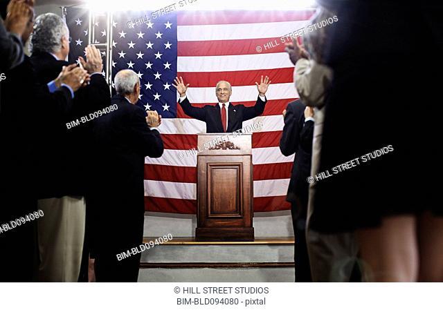 Caucasian politician making a speech at podium