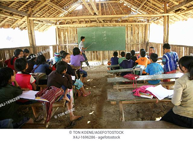 A teacher instructs pupils at a primary school in Mae Sot refugee camp Around 130,000 Burmese refugees have settled in Thailand due to opression in their...