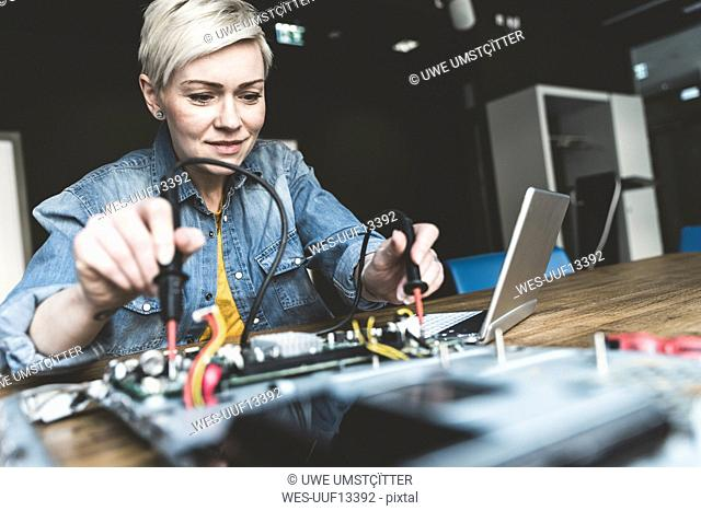 Woman working on computer equipment
