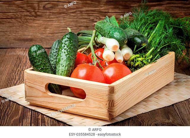 Vegetables from the home garden in a wooden box. Selective focus
