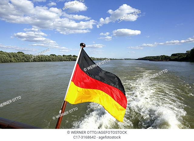 Batina, tourism, holiday, freetime, Danube river cruise, Danube navigation, German flag at the stern of the aROSA cruiser Mia, Danube landscape