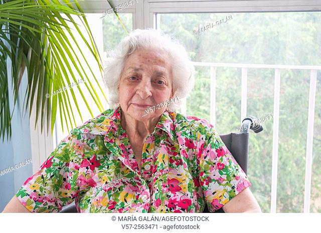 Elderly woman in a nursing home, smiling and looking at the camera
