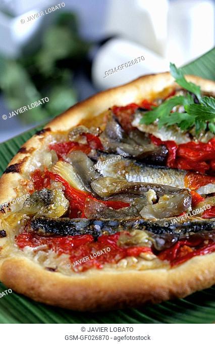 Coca de recapte savoury pastry with vegetables and sardines