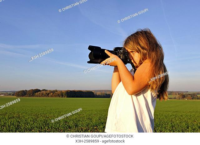 little girl shooting in the countryside, France, Europe