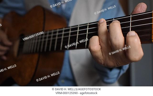 Musician plays guitar in Providence, Rhode Island