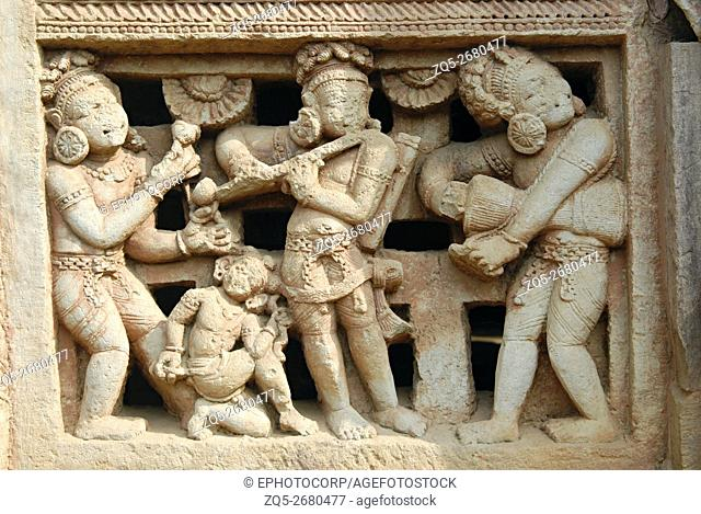 Orissa Bhubaneshwar Parasuramesvara Temple- Right of main entrance door showing dancing figures with flute player in centre