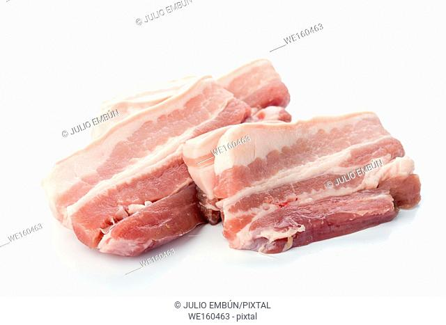 pieces of raw pork belly, isolated on white background