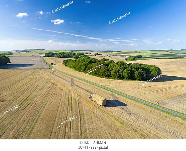 Aerial View Of Transporting Straw Bales On Trailer After Harvest