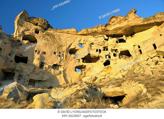 Part of cliff dwelling complex of ancient Christian churches and houses in village of Cavusin near Goreme, Cappadocia, Turkey