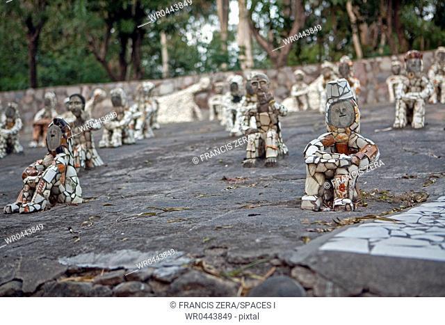 Small Figurines in Rock Garden