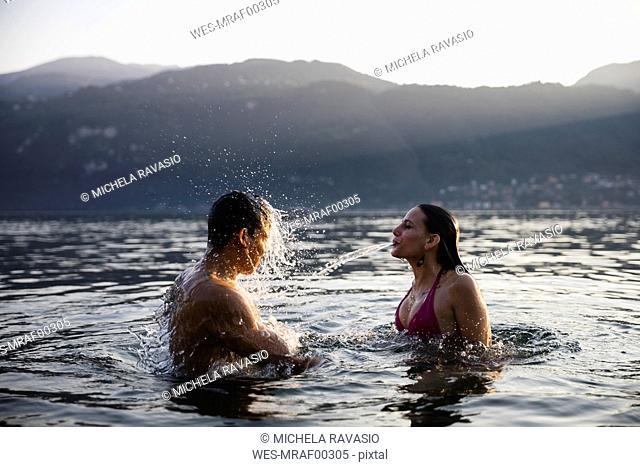 Young couple having fun in a lake
