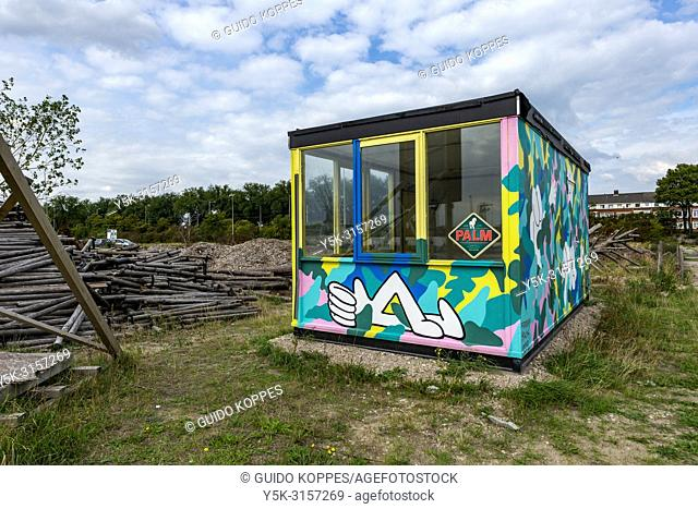 Rotterdam, Netherlands. Small cabin and little mini building inside newly developing wasteland of Port of Rotterdam Merwehabour
