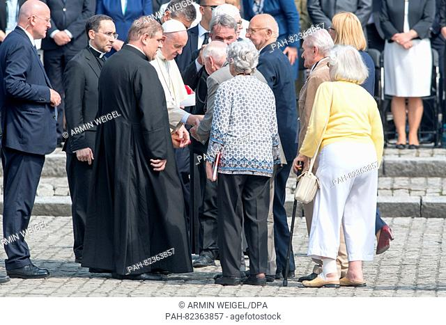 Pope Francis (C) meets people who had rescued jews from death during the Holocaust at the former Nazi extermination camp Auschwitz-Birkenau in Oswiecim