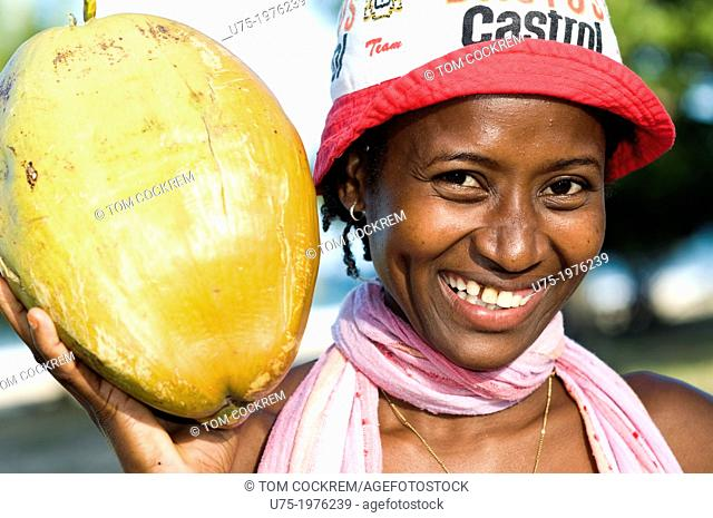 young woman outdoors with coconut in Madagascar