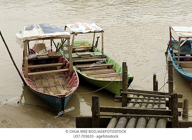Small boats (Sampan in Malay's words) tied to the wooden jetty at Bako, Sarawak, Malaysia