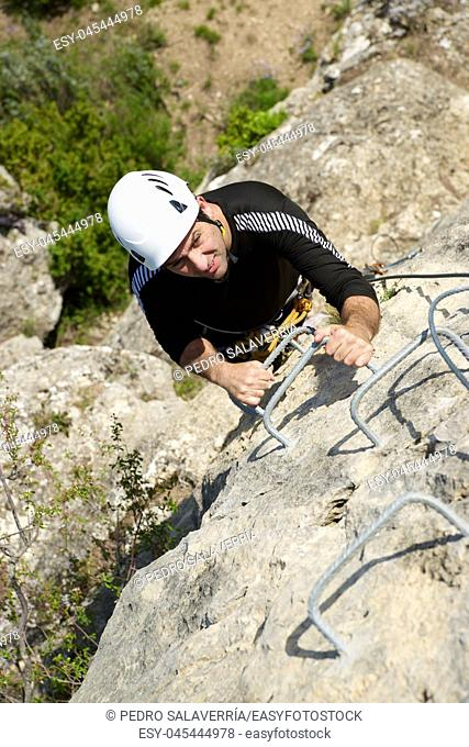 Climbing a Ferrata route in Calcena, Zaragoza Province, Aragon, Spain