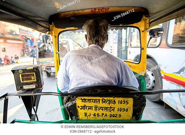 Man riding in rickshaw in Jaipur, India