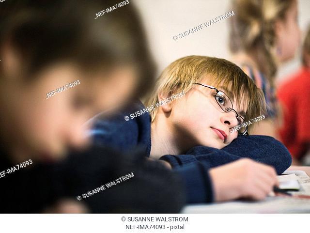Boy daydreaming at school, Sweden