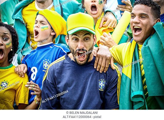 Brazilian football fans celebrating victory at match