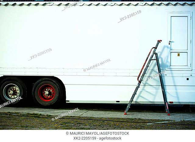 ladder and hidden door at the side of a truck