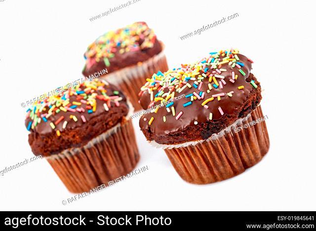 Three chocolate muffins