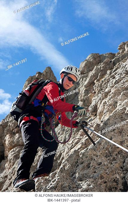 Climber on the Masara-Corda Rossa via ferrata, Dolomites, South Tyrol, Italy, Europe