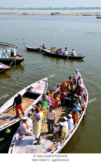 Pilgrims on the boat early morning at Ganges river