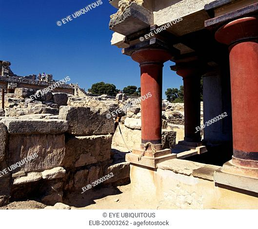 Knossos, ruins of the former Minoan capital, red columns in foreground