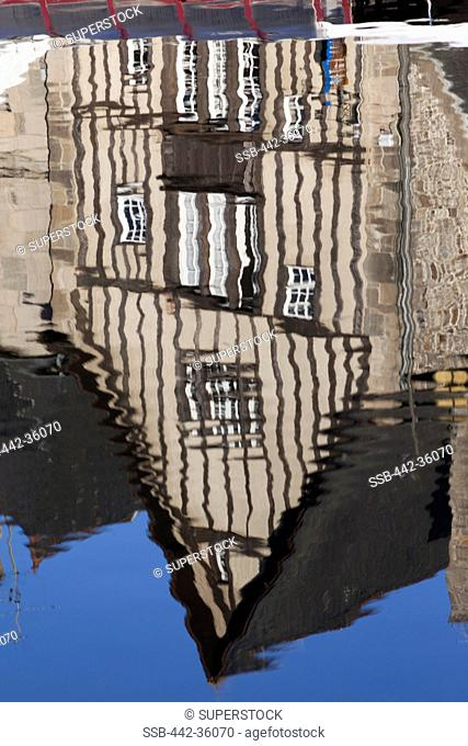 France, Brittany, Cotes-D'Armor, Dinan, Reflection of building in water