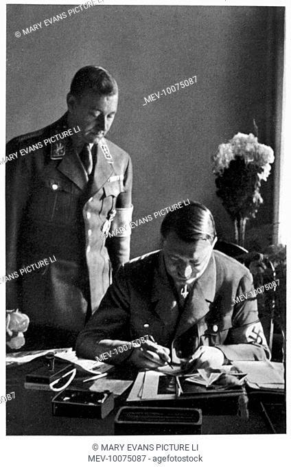 ADOLF HITLER Working at his desk in the Braune Haus, Munich, circa 1933