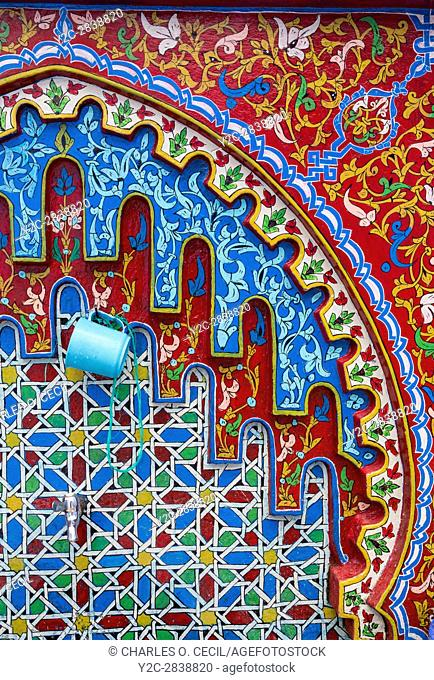 Chefchaouen, Morocco. Public Water Tap in the Medina Decorated with Floral and Geometric Designs