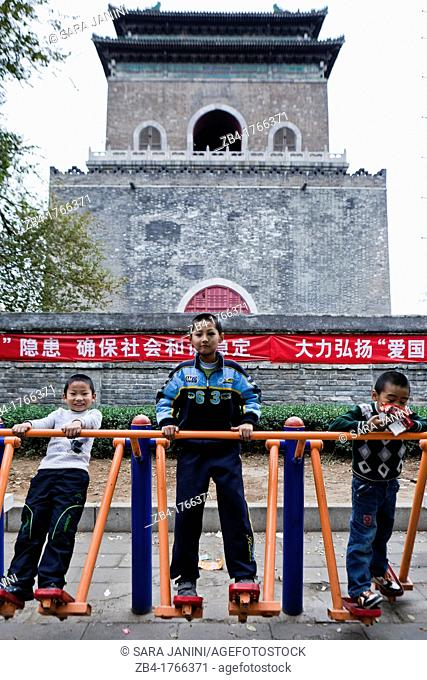 Children playing in a park near the Bell Tower, Beijing, China, Asia