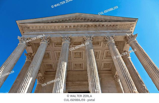 Low angle view of Maison Carree facade, Nimes, Languedoc-Roussillon, France